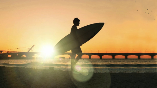 Surfer at the sunset