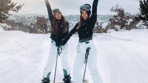 Happy girls skiing