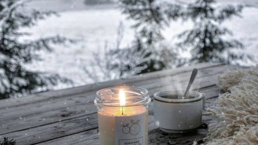 Steamy drink, candle, snow