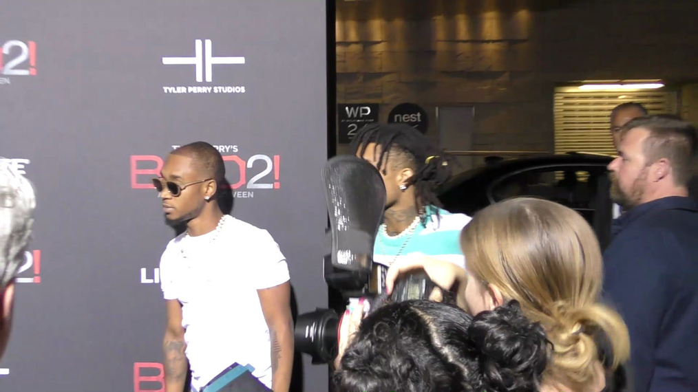 Swae Lee and Slim Jxmmi of Rae Sremmurd at the Tyler Perry's Boo 2! A Madea Halloween Premiere at Regal LA Live Theatre in Los Angeles.mp4