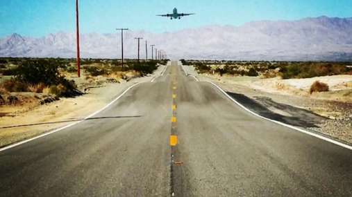 Plane above the road 66