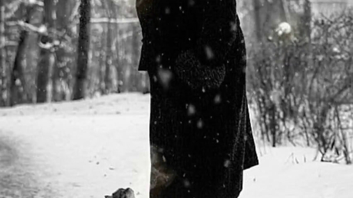 Woman and a cat in the snow