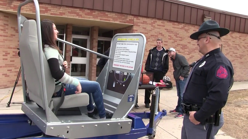 Gering High School students use Seat Belt Convincer