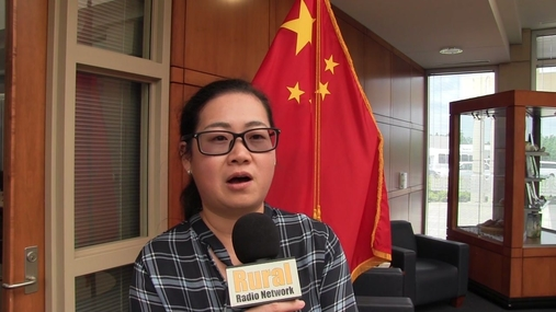 Ms. Xu Ying part of the China Sorghum Team talks trade