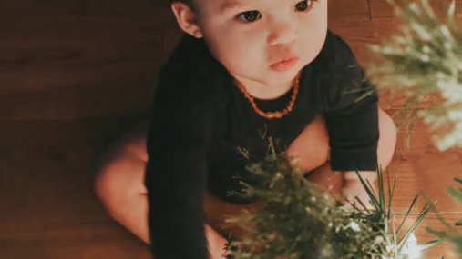 Baby and the christmas tree