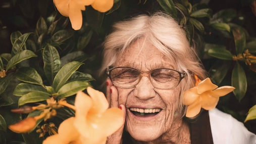 Happy grandma with flowers