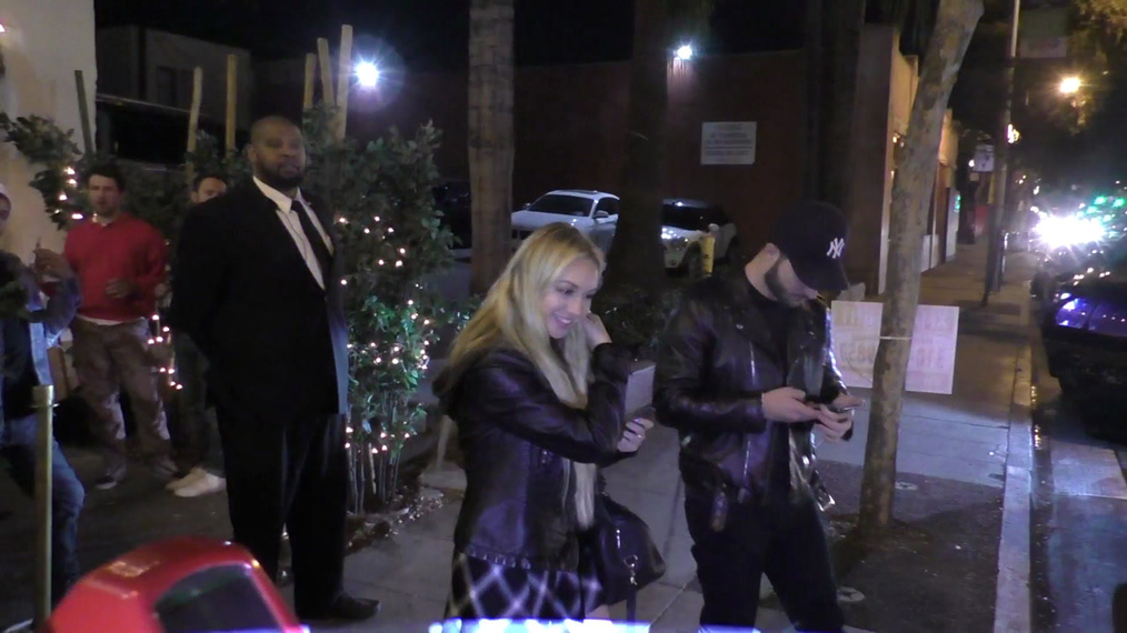 Corinne Olympios flips off paparazzi outside Delilah's Nightclub in West Hollywood.mp4