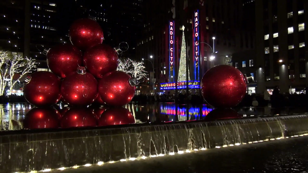 Red Christmas Balls in Fountain with Radio City Music Hall in background in New York.mp4