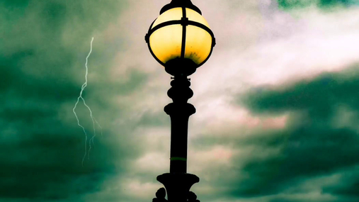Lightning behind the lamp